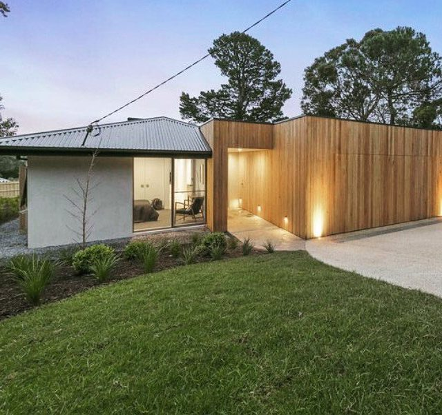 Timber Cladded Garage  The natural Silvertop Ash features arehellip